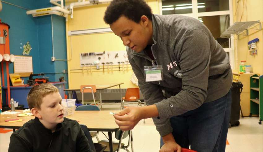 MIT student Joshua Verdejo teaching and creating electric circuits with Bagnall sixth grade student Ian Anderson. (Courtesy Photo Bagnall Elementary School)