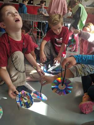 Second grade students Nicky Costa, left, and Lucas Johnson upcycled CDs during a STEM Week activity at Bagnall Elementary School on Tuesday. (Courtesy Photo Pentucket Regional School District)