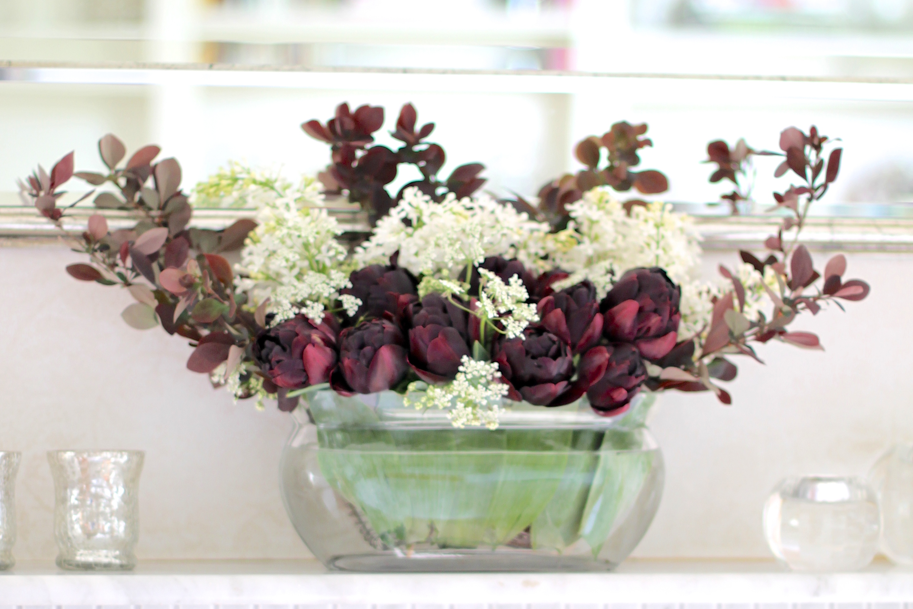 In a vase on monday white lilac with a black tulipindulging spring mantle arrangement reviewsmspy