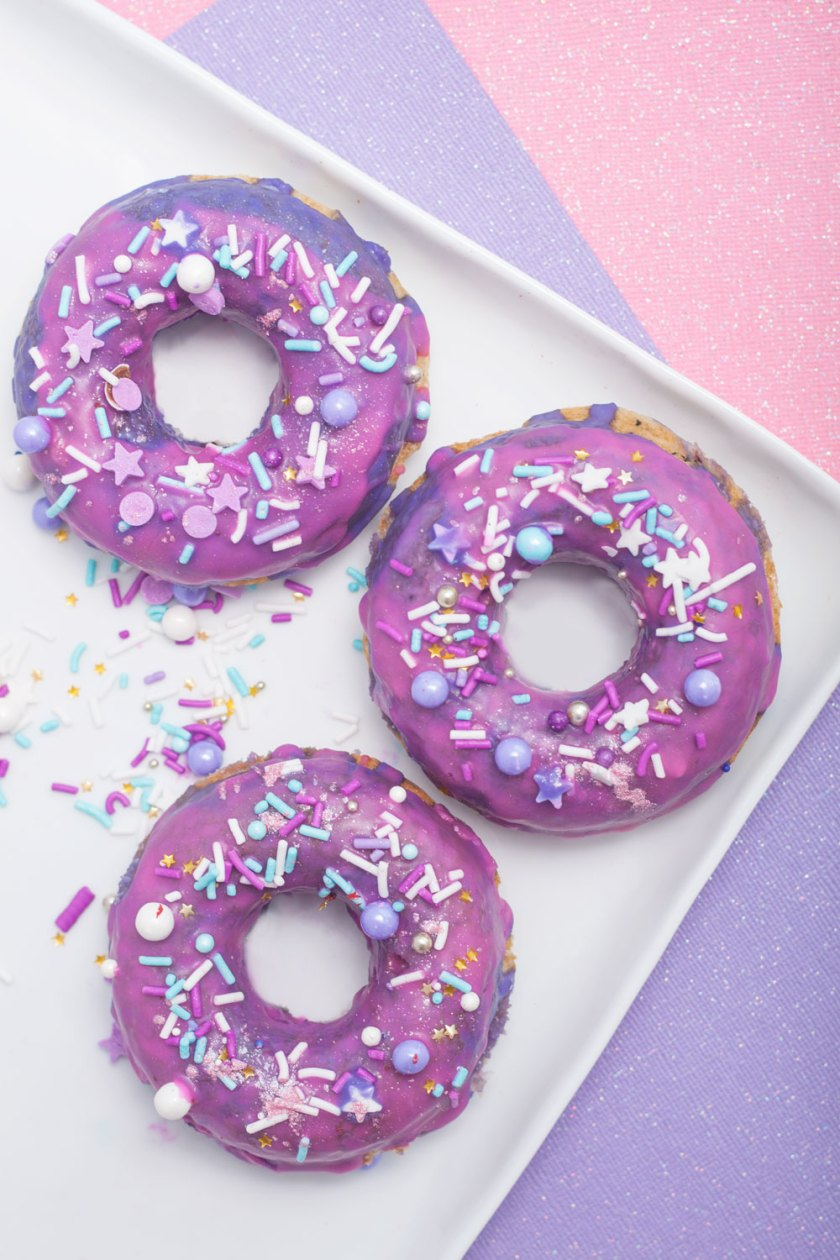 Sparkling sprinkles with pink and purple glaze, these Unicorn Sprinkle Doughnuts are perfect for National Doughnut Day (which is every day, obviously).