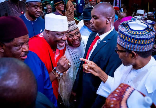 Dino-fist-greeting-of-Buhari-stirs-tweetstorm