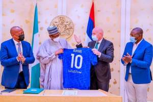 Buhari receiving No 10 jersey from FIFA President, Infantino