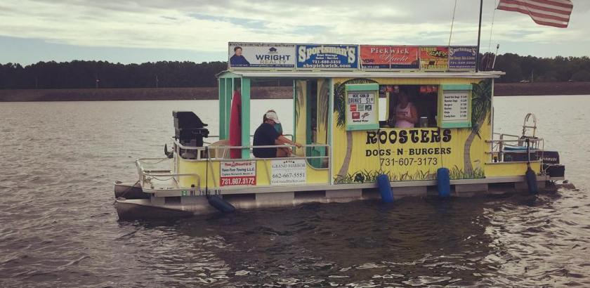 Rooster's Dogs & Burgers surrounded by hundreds of boats attending a strange boat-in only concert in Northern Mississippi-in