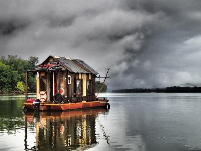 Storm looming above the shantyboat. Photo by Adrian Nankivell