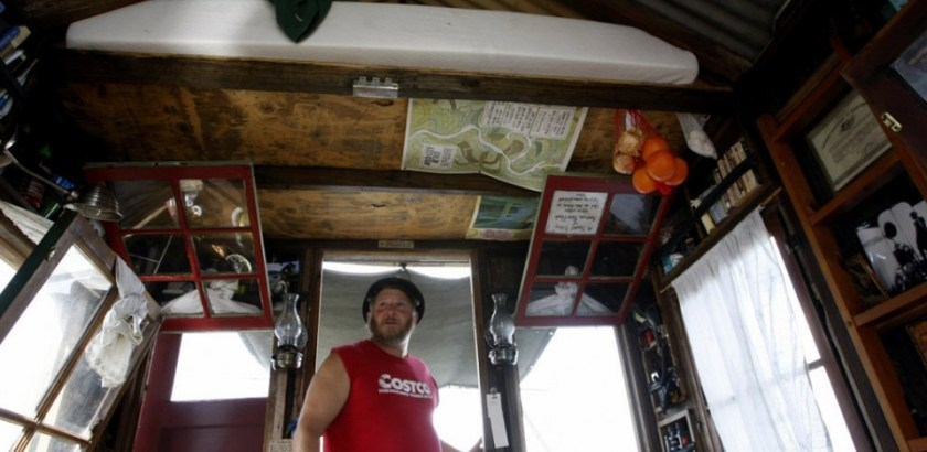 """Artist Wes Modes aboard the shantyboat Dotty, floating down the Tennessee River this summer as part of Modes' oral history project """"A Secret History of American River People."""" (Dennis Pillion 