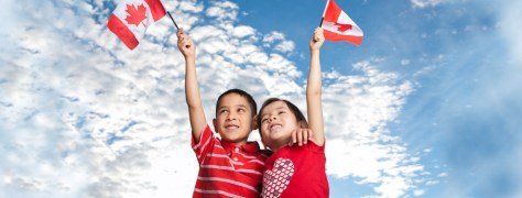 boy-holding-canadian-flag