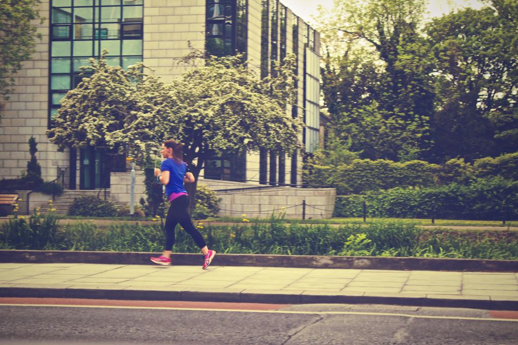 Photo of runner on sidewalk