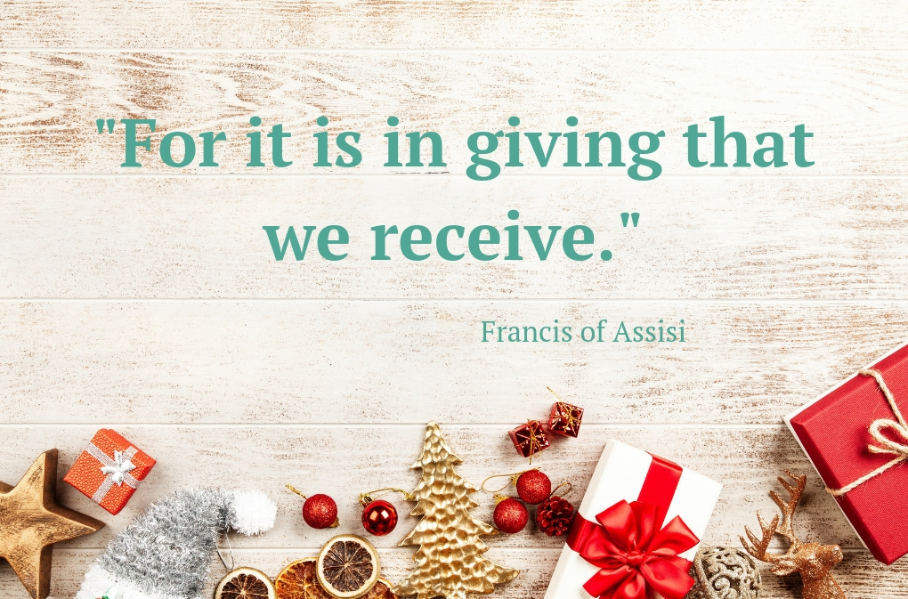 "gifts against a white-washed wood background with text that says ""For it is in giving that we receive."""