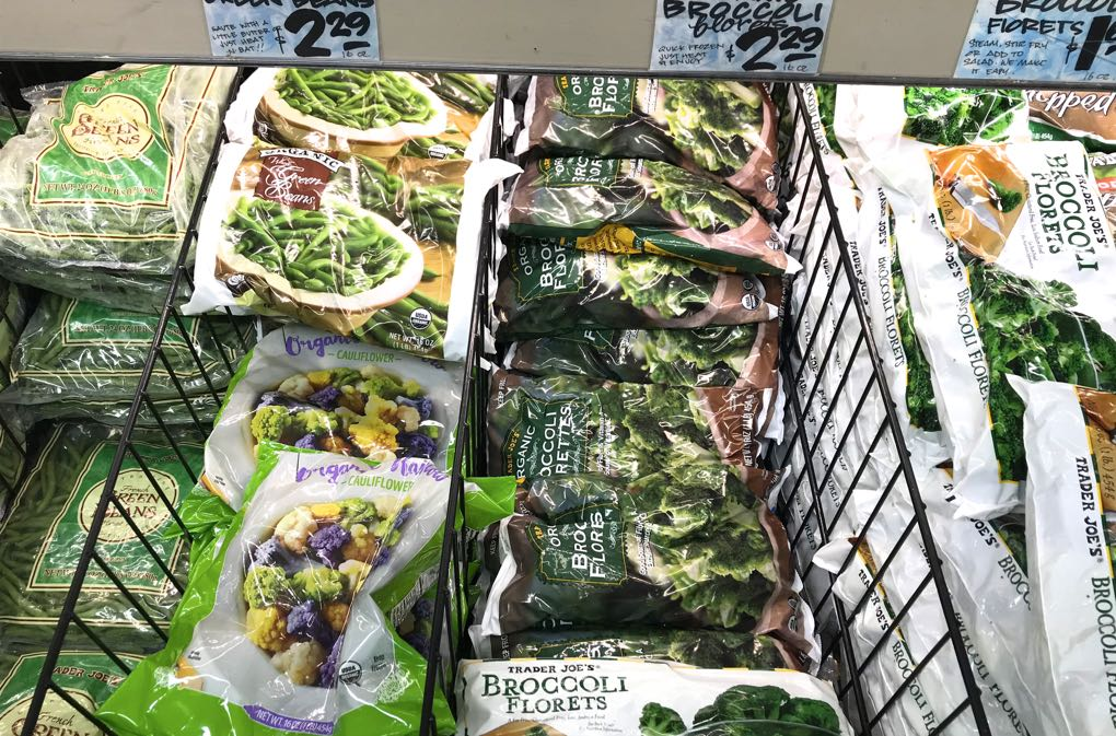 Image of frozen vegetables in grocery store that are good when buying food during a crisis