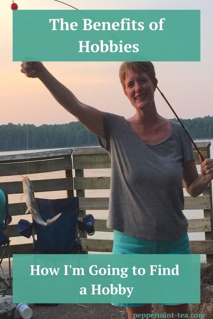 Photo of Robyn Mooring holding up fish on the end of fishing pole