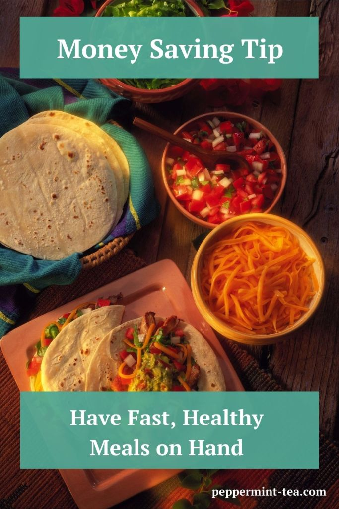 Photo of taco fixings in bowls and two tacos on a plate as an example of fast, healthy meals
