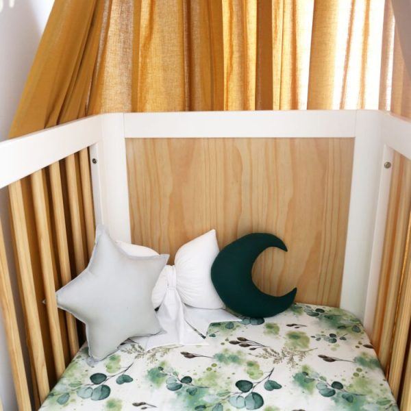 Cot Setup with leaf print sheet, mustard canopy, Medium Light Grey Star, Small Forest Green Moon and White Bow Cushions