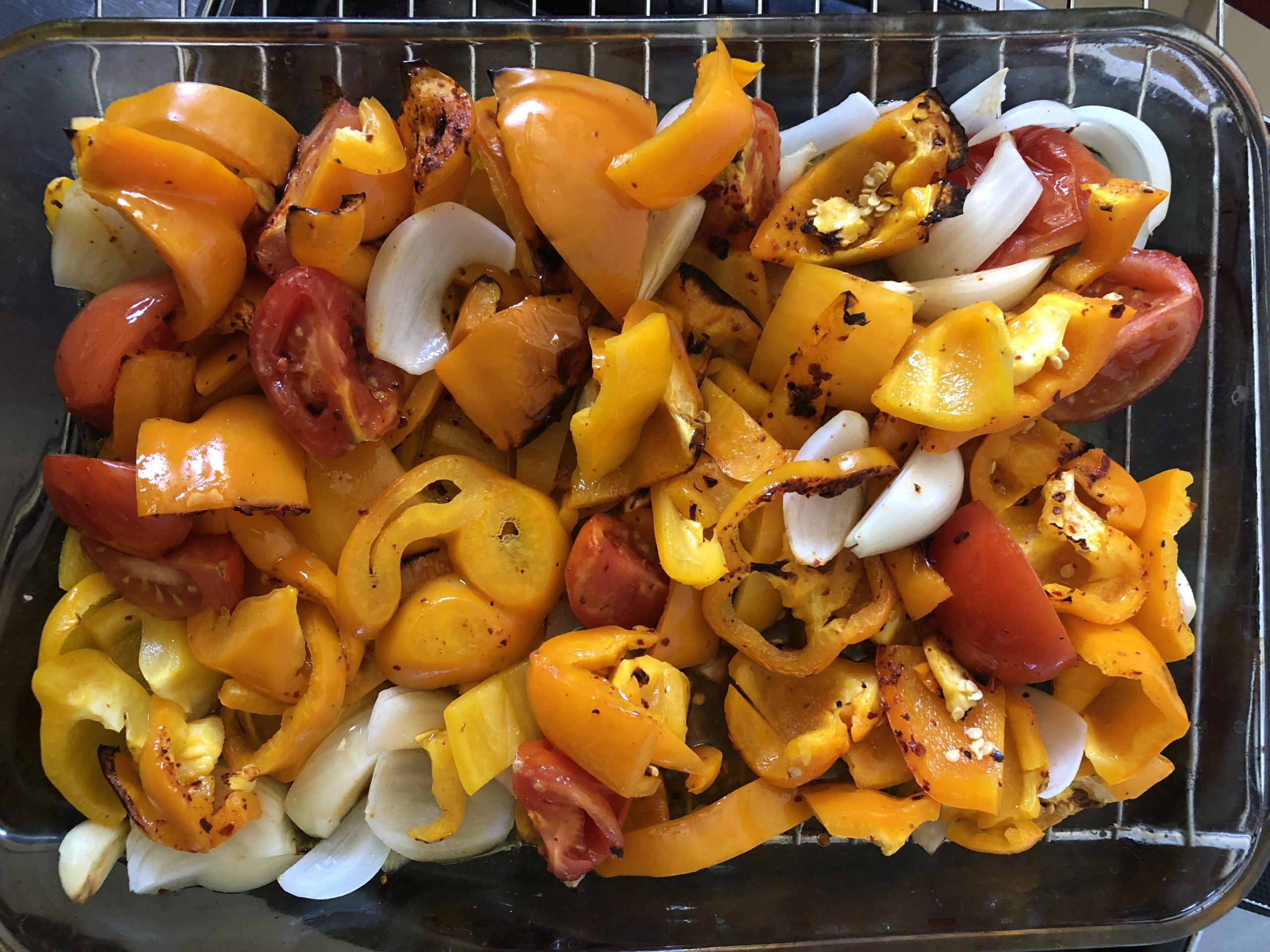 roasted peppers, tomatoes, onions, chili, garlic and olive oil