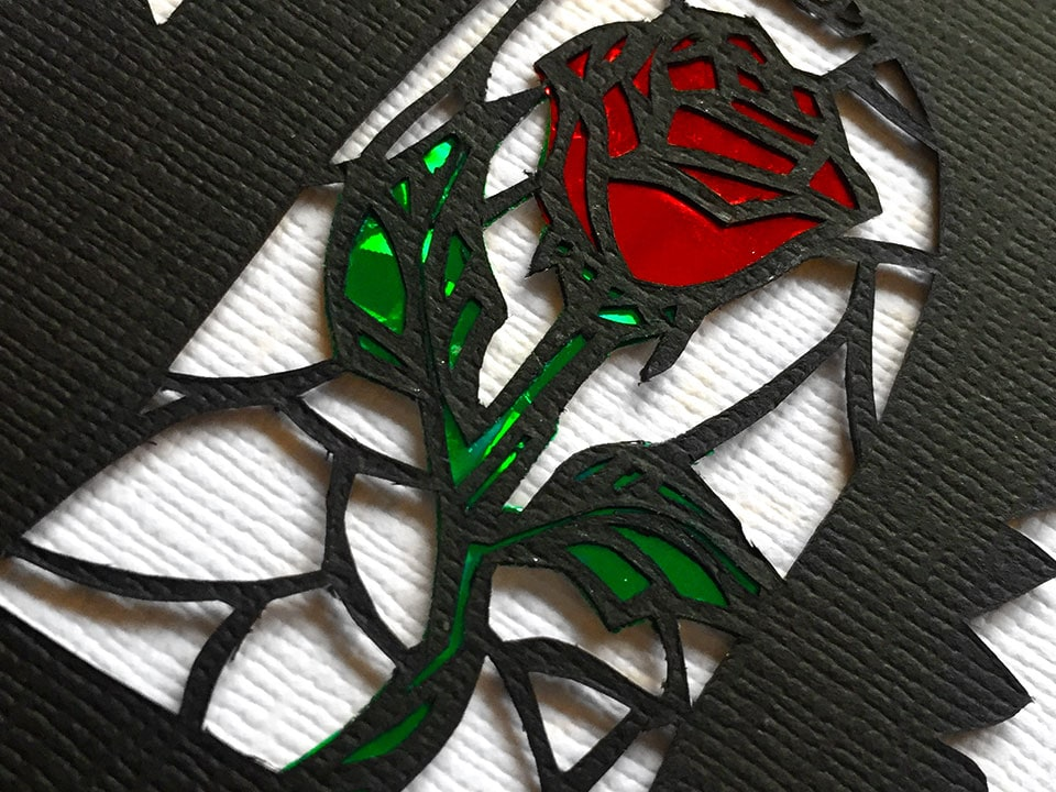 closeup of a hand made paper cut rose