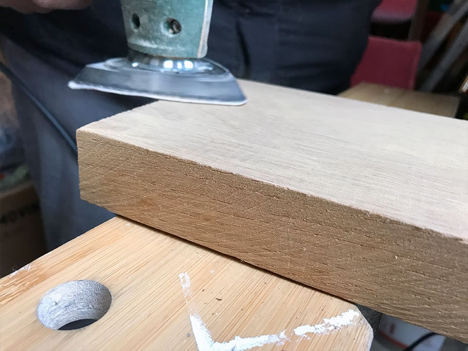sanding the wood for the bottle opener