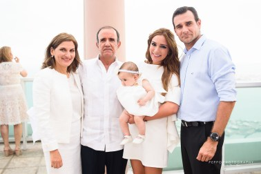 Familia en bautizo -Peppophotography