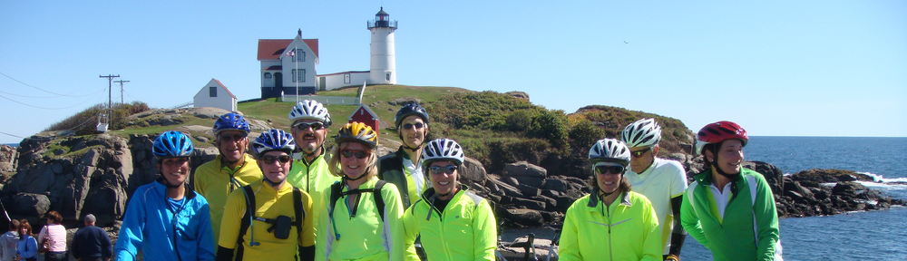 rider in front of lighthouse