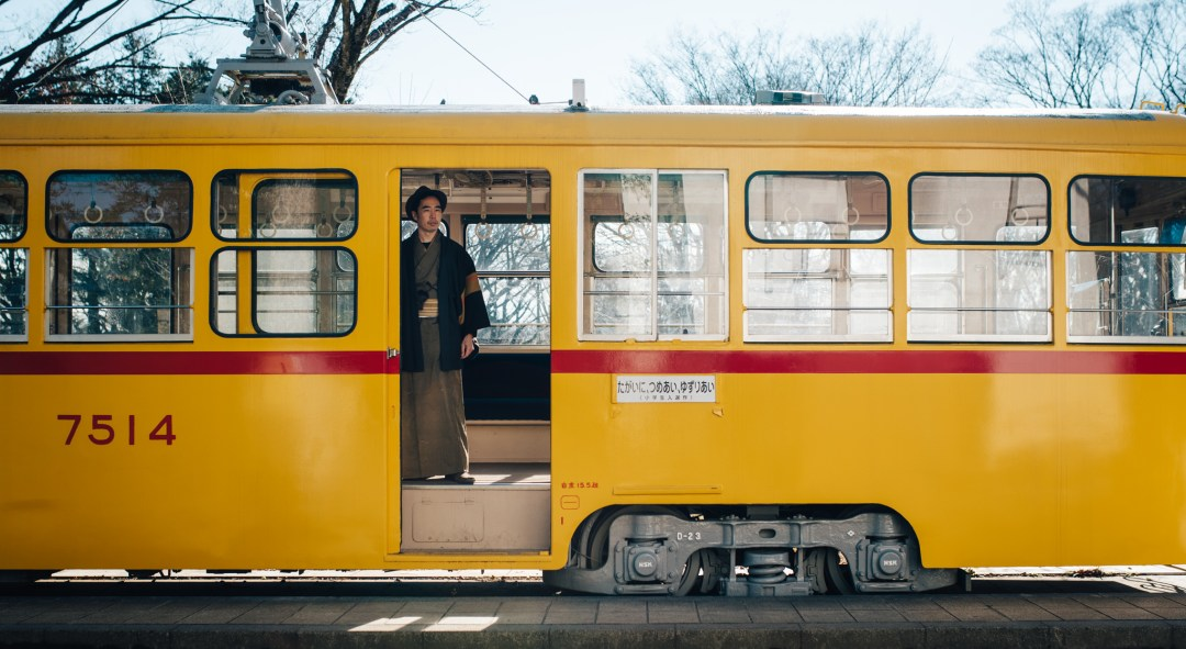 author and photographer todd fong in kimono on yellow train