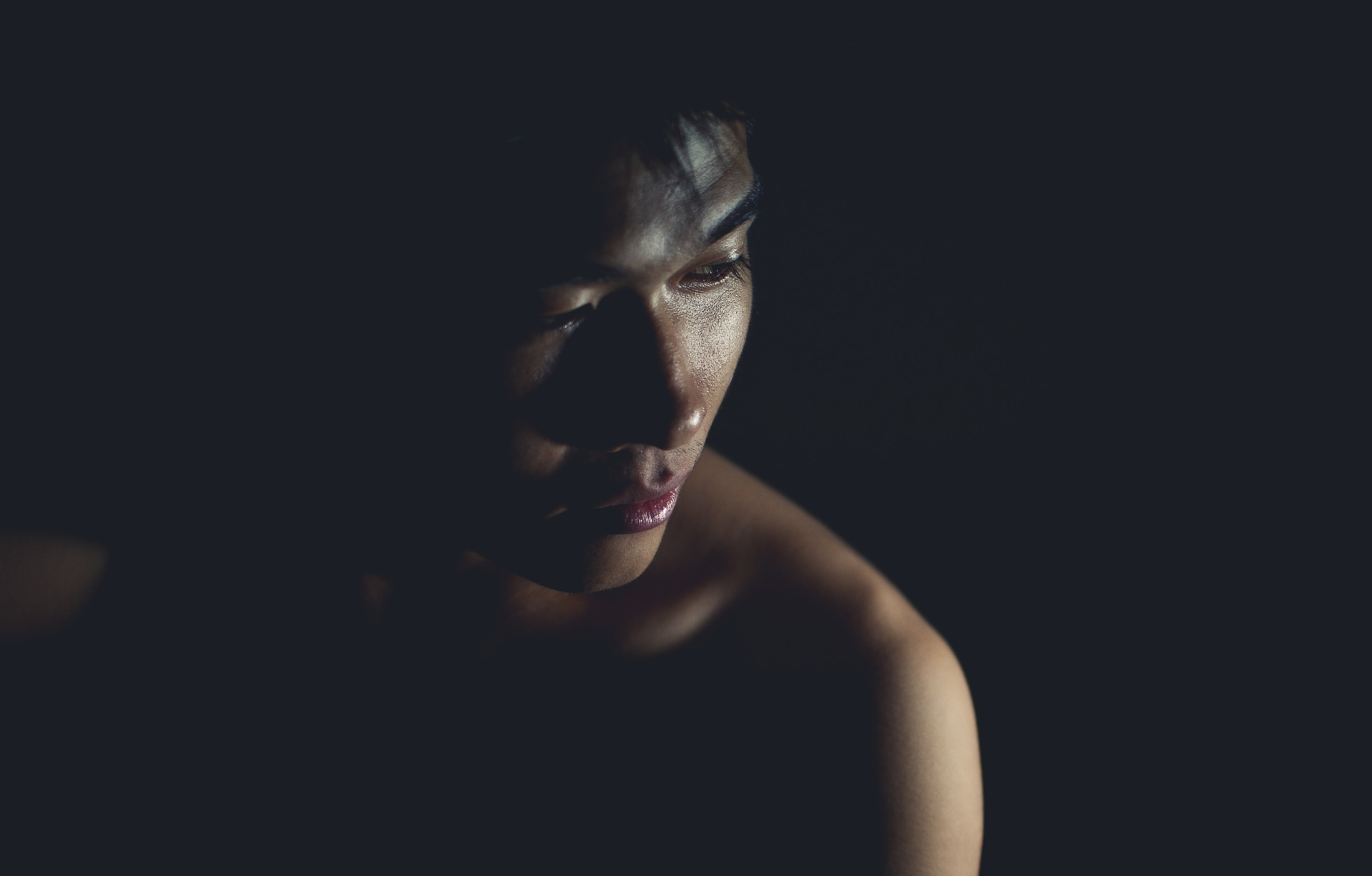 A picture of Asian American man in the dark