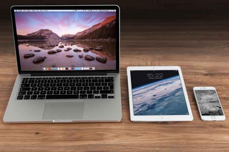 macbook pro beside white ipad