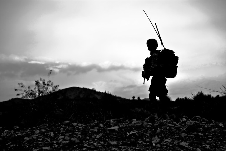 Black and white image of a an American soldier in Afganistan