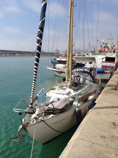 The rugged little fishing boat behind is the one that towed us in...