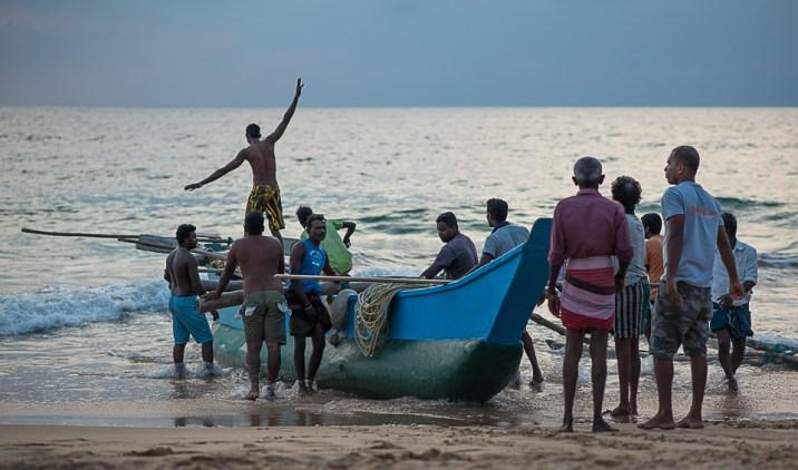 Fishermen pushing out for the evening trawl, Hikkaduwa