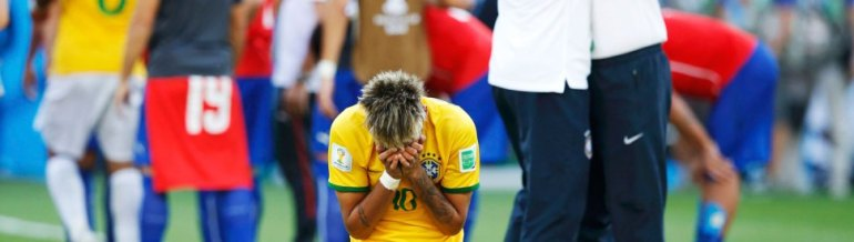Brazil's Neymar reacts as his team celebrates their penalty shootout win against Chile after their 2014 World Cup round of 16 game at the Mineirao stadium in Belo Horizonte