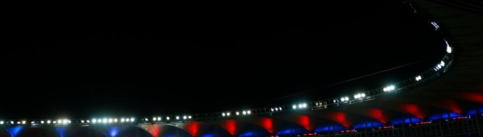 Match highlights are screened after the 2014 World Cup Group B soccer match between Spain and Chile at the Maracana stadium in Rio de Janeiro