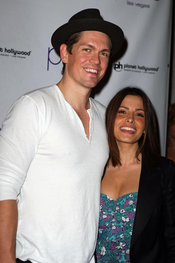 Steve Howey and Sarah Shahi celebrating their engagement in 2009