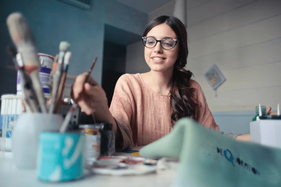 girl happily painting