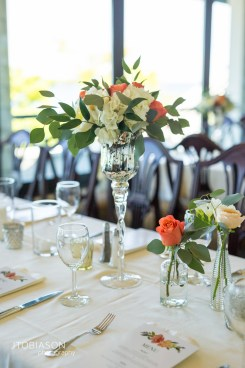 Seattle Tennis Club wedding in Seattle  Orange and white flower centerpieces with greenery in glass vase   Perfectly Posh Events, Seattle Wedding Planner   JTobiason Photography   Sublime Stems