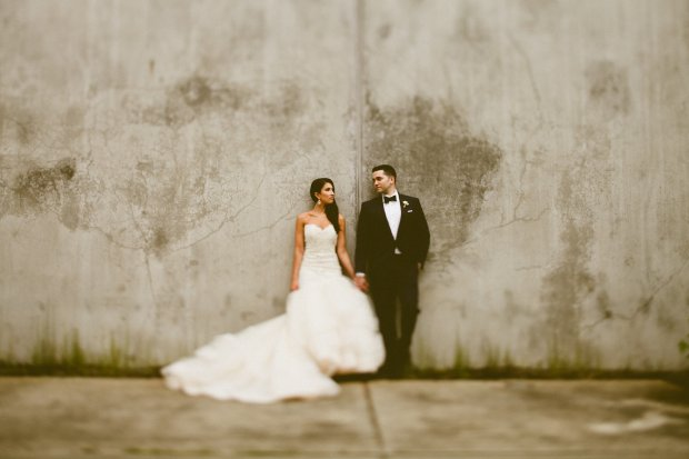 DeLille Cellars wedding in Woodinville | Bride & Groom standing against concrete wall | Perfectly Posh Events | Seattle Wedding Planner | Andria Lindquist Photography