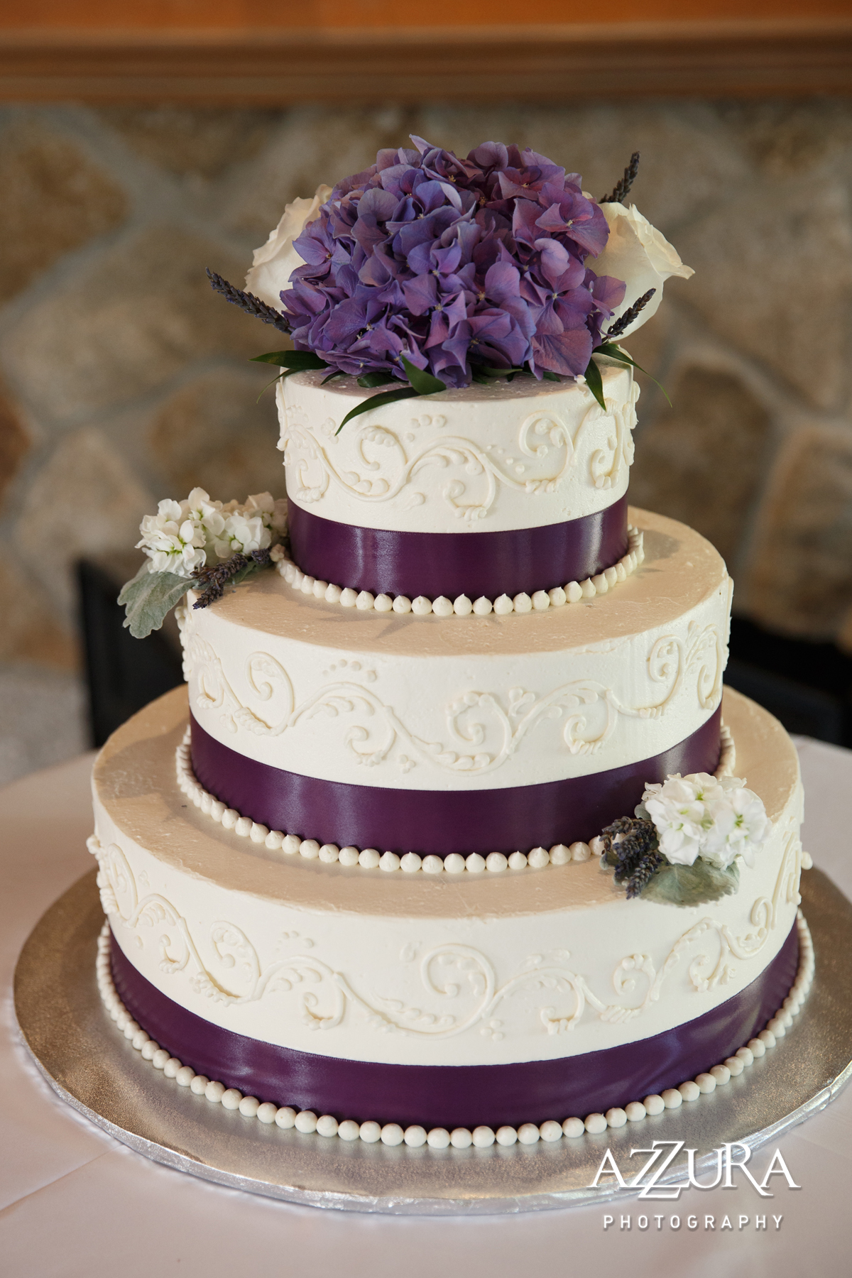 Laurel Creek Manor Wedding in Seattle | Purple hydrangea cake topper on three-tiered wedding cake with purple ribbon | Perfectly Posh Events, Seattle Wedding Planner | Azzura Photography | Sublime Stems