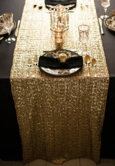 Sequin gold table runner with black tablecloths