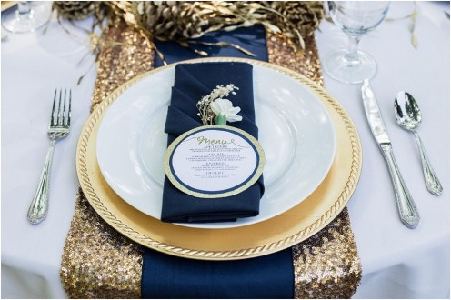 Gold table runner with navy napkin, gold charger plate, and round menu | Bethany Carson Photography