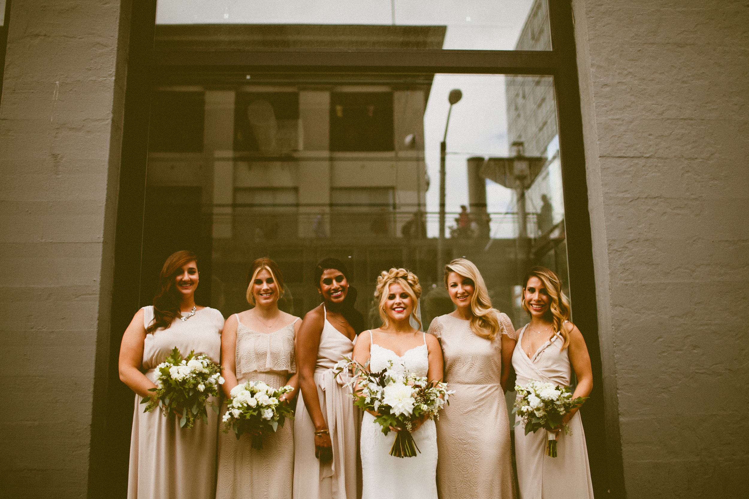 Sodo Park Wedding in Seattle | Neutral bridesmaids dresses with white bouquets with greenery | Perfectly Posh Events, Seattle Wedding Planner | Andria Lindquist Photography | Botanique