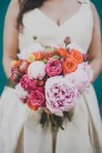 Mid-Century Modern bridal bouquet, pink, fuchsia, coral, mandarin orange, peony, garden roses | Venue: The Foundry by Herban Feast, Seattle WA | Floral Design: Butter & Bloom | Wedding Planning & Design: Perfectly Posh Events, Seattle Wedding Planner | Photographer: Carina Skrobecki Photography |