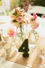 DeLille Cellars wedding in Woodinville   Moss wrapped table number with multiple smaller floral vases   Perfectly Posh Events   Lucid Captures Photography   Bella Signature Design