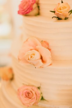 DeLille Cellars wedding in Woodinville   Three-tiered white buttercream cake with roses   Perfectly Posh Events   Lucid Captures Photography   Morfey's Cakes
