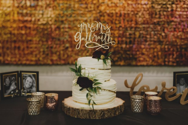 Cedarbrook Lodge wedding in Seattle | Three tiered, white, buttercream frosted wedding cake with gold trim and dark red roses for decor | Perfectly Posh Events | Carly Bish Photography | Butter & Bloom