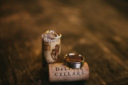 DeLille Cellars Wedding in Woodinville, WA | Wedding rings on top of wine corks from winery wedding | Perfectly Posh Events | Lucid Captures Photography