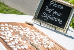 Wooden sign with tree and leaves for guests to sign as guestbook | Meadowbrook Farm Wedding, Snoqualmie, WA | Perfectly Posh Events, Seattle Wedding Planner | Sasha Reiko Photography | Jesse + Wes Wedding // © Sasha Reiko Photography
