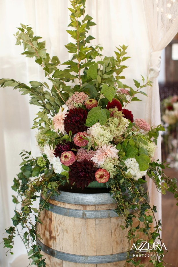 Sodo Park with Herban Feast Wedding in Seattle   Real Wedding use of Greenery, 2017 Pantone Color of the Year   Full, elegant arrangement with greenery, burgundy, pink, and cream florals on wine barrel   Perfectly Posh Events, Seattle Wedding Planning   Azzura Photography   Floral Design by Nova