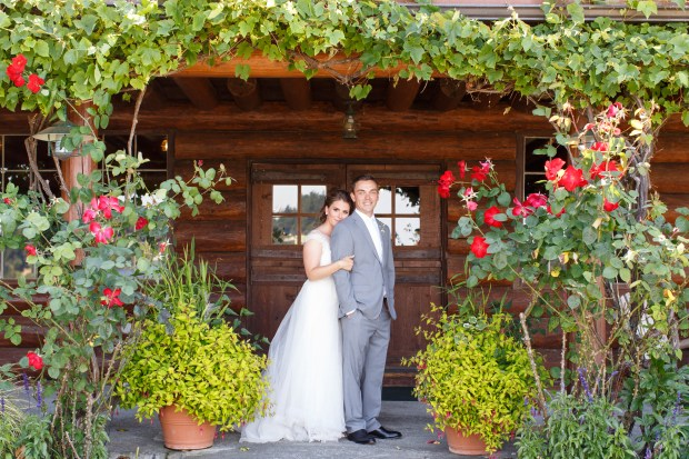 Kiana Lodge Wedding on Bainbridge Island   2017 Pantone Color of the Year, Greenery   Hanging greenery and colorful garden for bridal portrait backdrop   Designed + Coordinated by Perfectly Posh Events   Amelia Soper Photography   Floral Design by Melanie Benson Florals