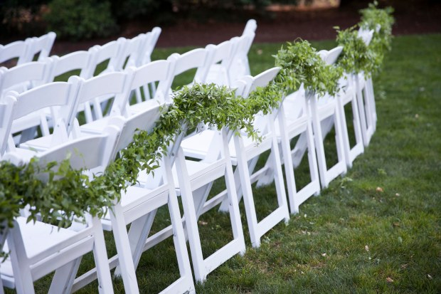 Laurel Creek Manor Wedding in Sumner | Greenery garland for ceremony chairs | Design + Coordinated by Perfectly Posh Events | Katie Parra Photography | Floral Design by Flora Nova