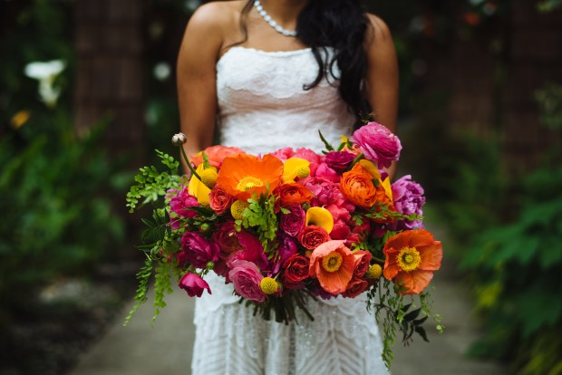 Kiana Lodge Wedding on Bainbridge Island, WA | Loose, garden bridal bouquet arrangement with vibrant colors, pink, orange, and yellow blooms | Perfectly Posh Events, Seattle Wedding Planning | Shane Macomber Photography | Floral Design by Flora Nova