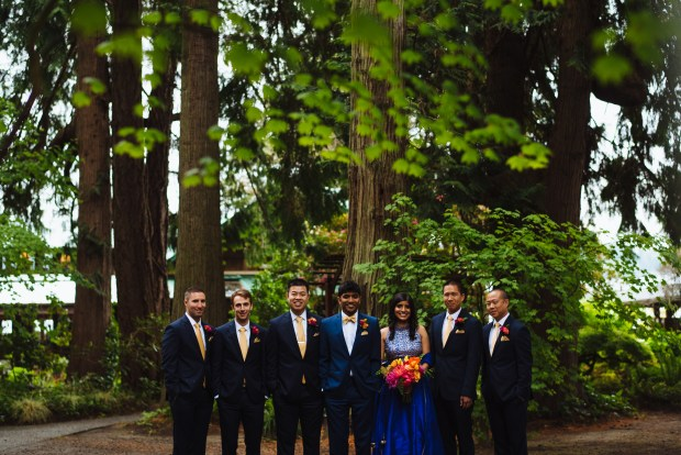 Kiana Lodge Wedding on Bainbridge Island, WA | Groomswoman in a navy lengha and colorful bouquet amongst groom and groomsmen | Perfectly Posh Events, Seattle Wedding Planning | Shane Macomber Photography | Floral Design by Flora Nova