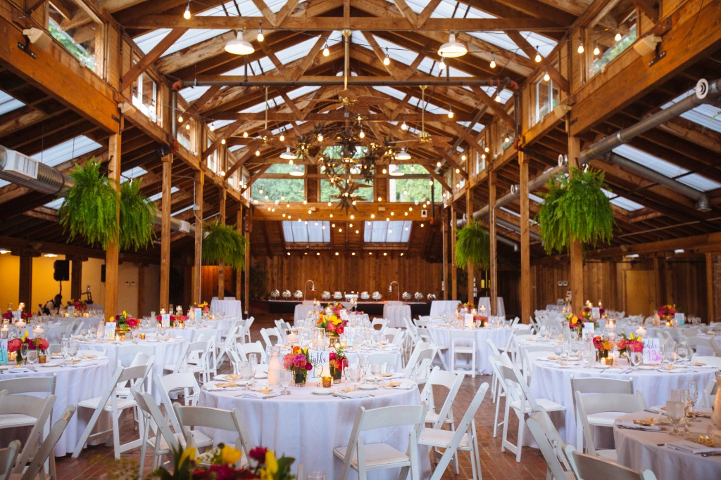 Kiana Lodge Wedding on Bainbridge Island, WA | Colorful PNW wedding reception in lodge with pink, orange, and yellow colors | Perfectly Posh Events, Seattle Wedding Planning | Shane Macomber Photography | Floral Design by Flora Nova