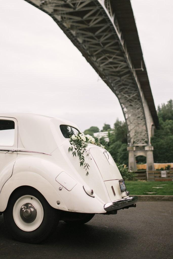 Axis Pioneer Square Wedding in Seattle | Seattle wedding photo location: Aurora Bridge, Seattle | Perfectly Posh Events, Seattle Wedding Planner | Roland Hale Photography | British Motor Coach; Vintage Car Rental, Seattle